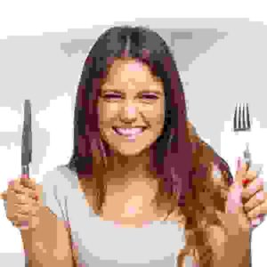 Portrait of a very hungry young woman